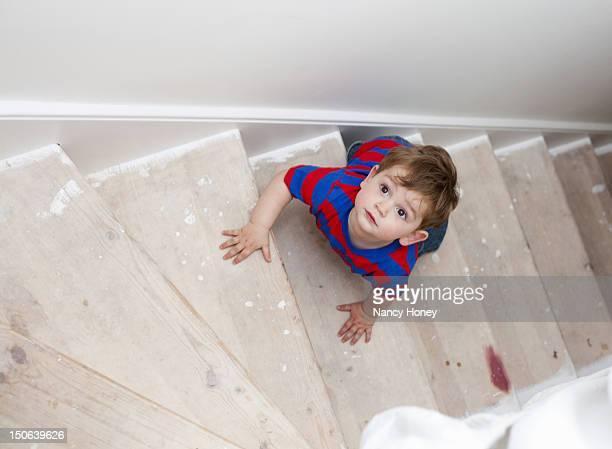 Toddler boy climbing steps