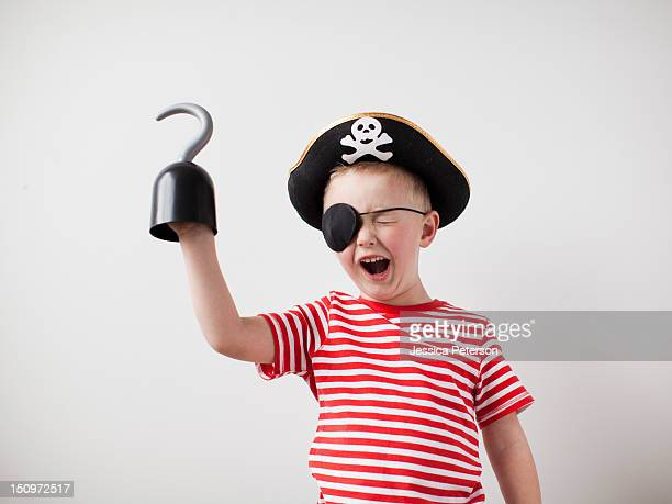 Toddler boy (2-3) dressed-up as pirate