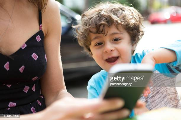 Toddler Boy Looking at a Smart Phone