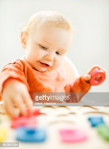 toddler boy playing with letters : Stock Photo