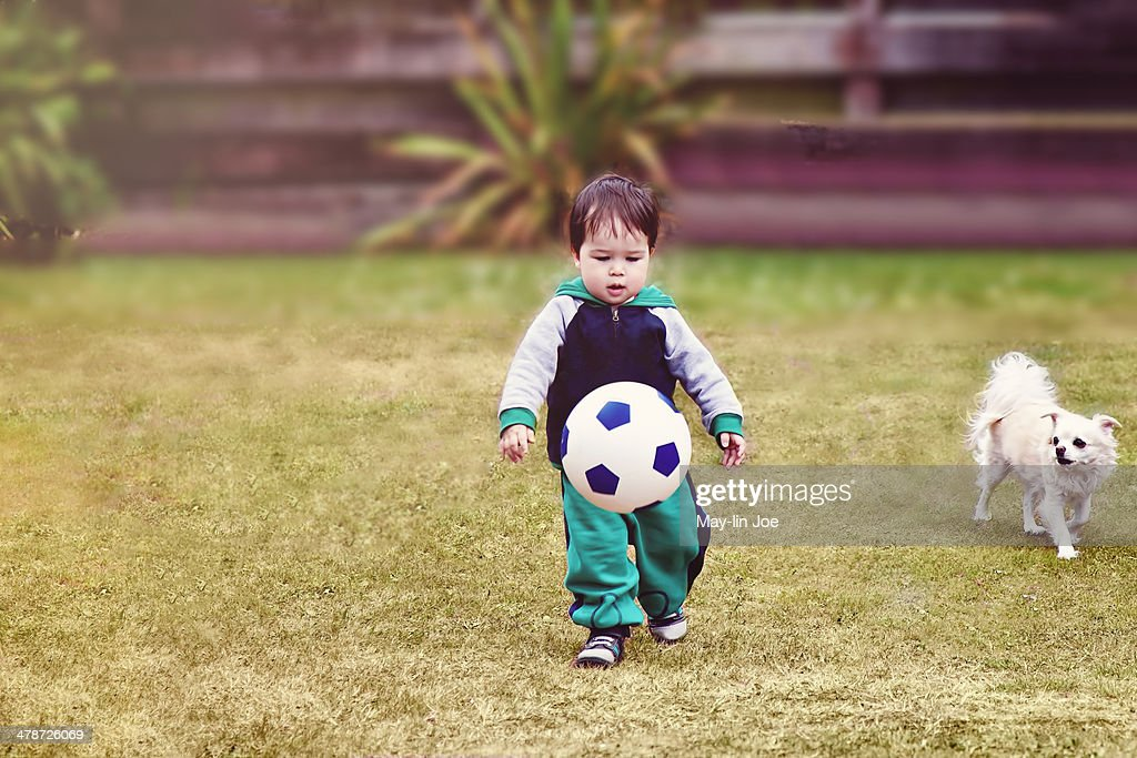 Toddler boy playing with soccer ball