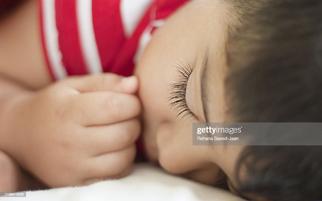 Toddler boy sleeping with hand near his mouth : Stock Photo