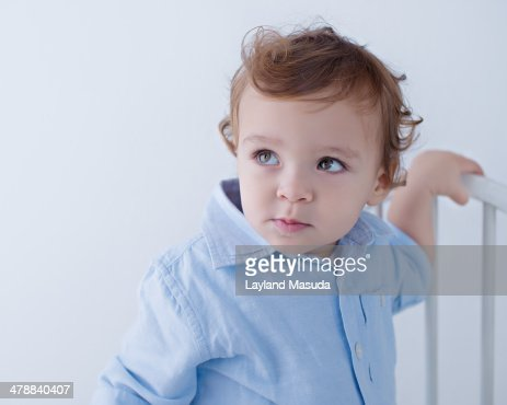 Toddler Boy With Curly Hair Indoors : Stock Photo
