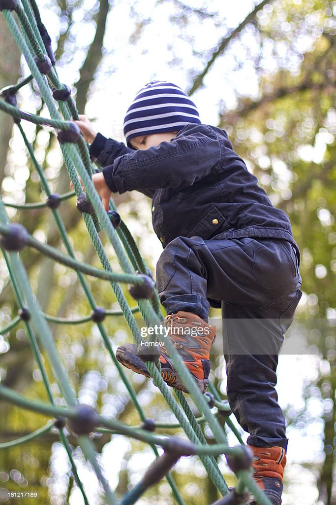 Toddler climbing on playground