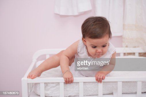 Toddler Climbing out of Crib (XXL) : Stock Photo