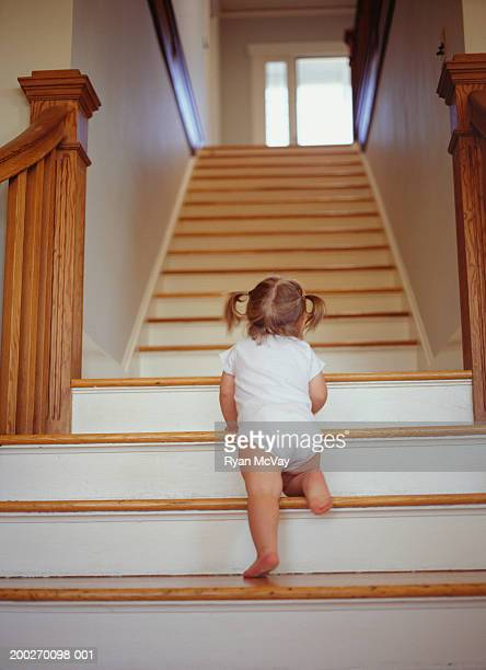 Toddler (18-21 months) climbing up stairs, low angle view