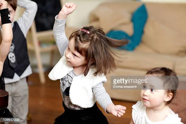 Toddler, dancing, arm raised
