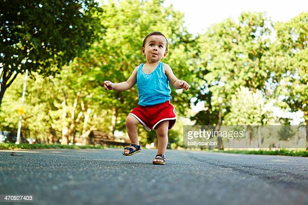 Toddler dancing in park