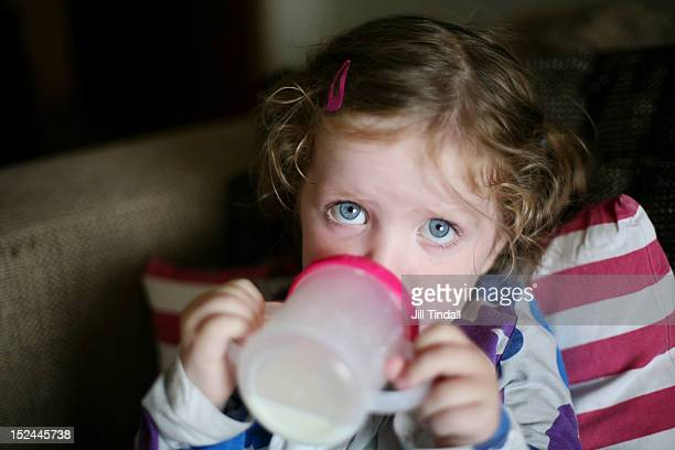 Toddler drinking milk from sippy cup