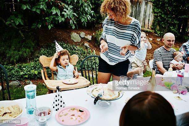 Toddler eating cake during birthday party