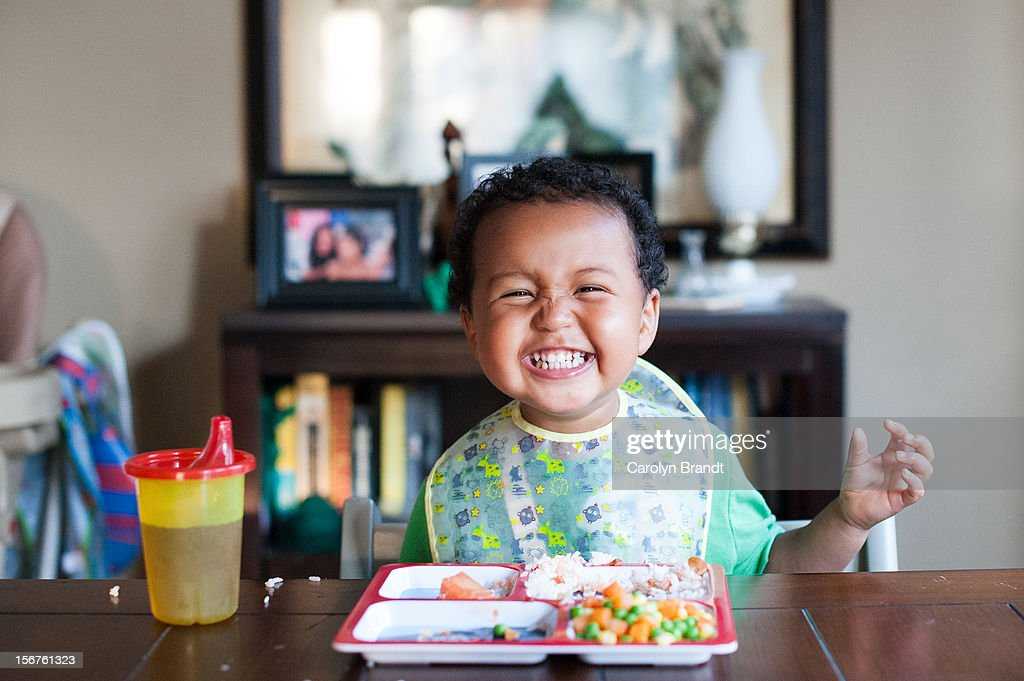 Toddler eating healthy lunch : Stock Photo