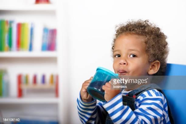 Toddler Enjoying Baby Juice At Nursery