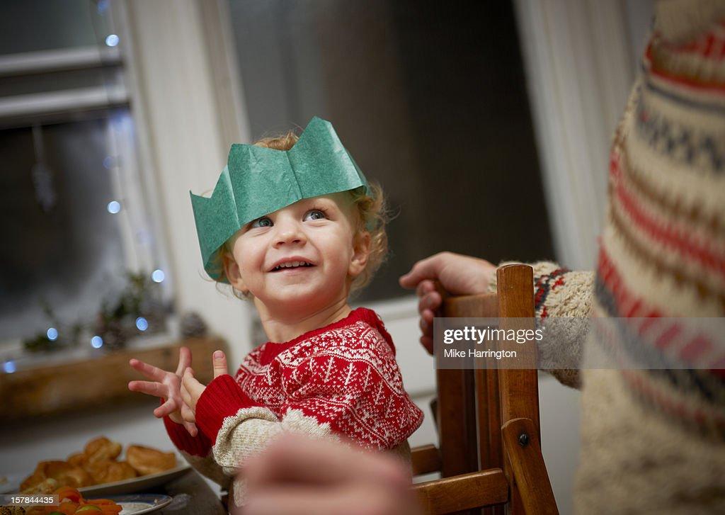 Toddler enjoying Christmas dinner. : Stock Photo
