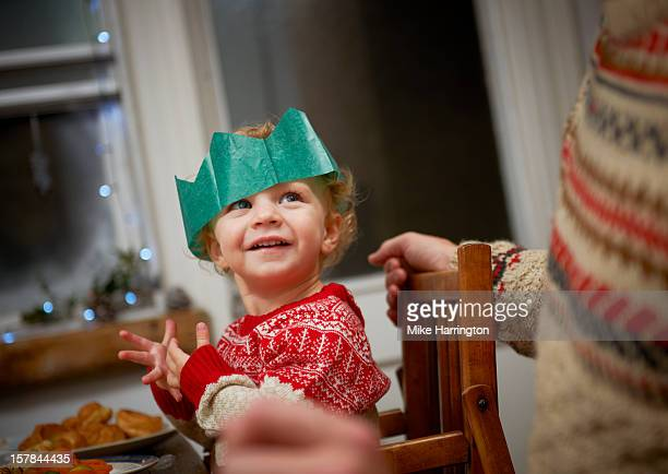 Toddler enjoying Christmas dinner.