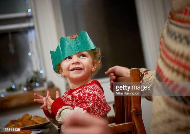 Toddler enjoying Christmas dinner.