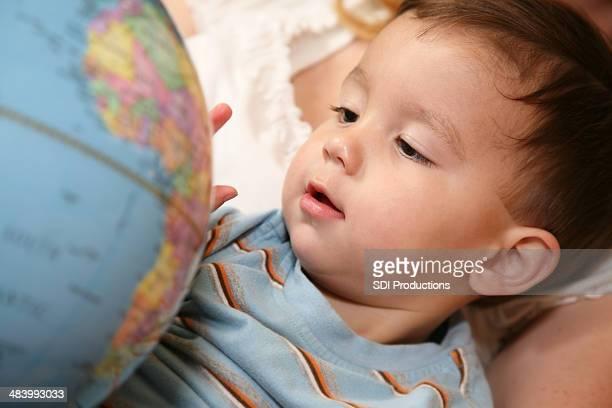 Toddler Enjoying Geography On A Globe