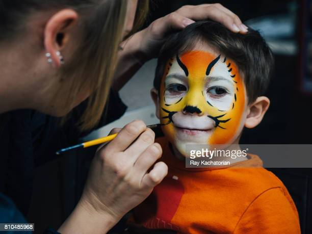Toddler getting face paint