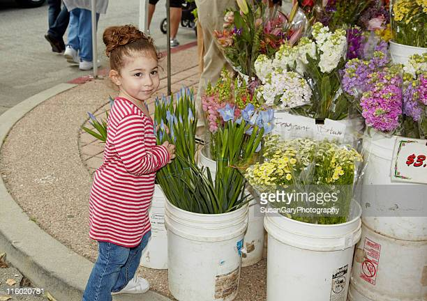 Toddler girl at flower stand