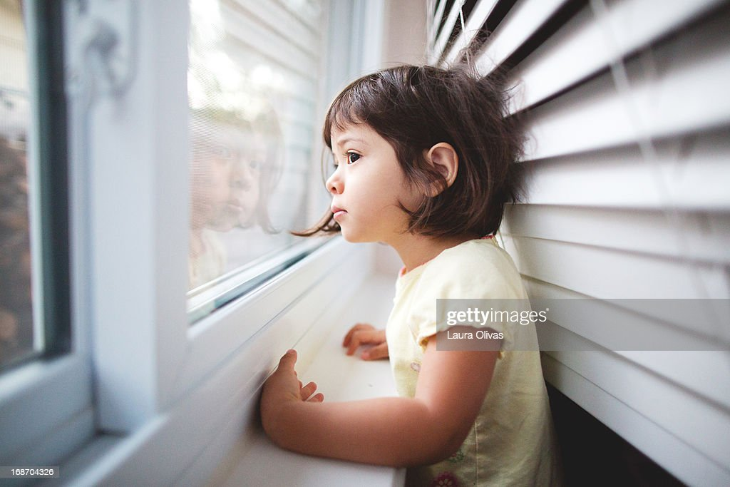 Toddler Girl By Window