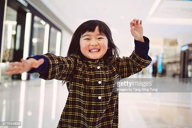 Toddler girl dancing in front of camera joyfully