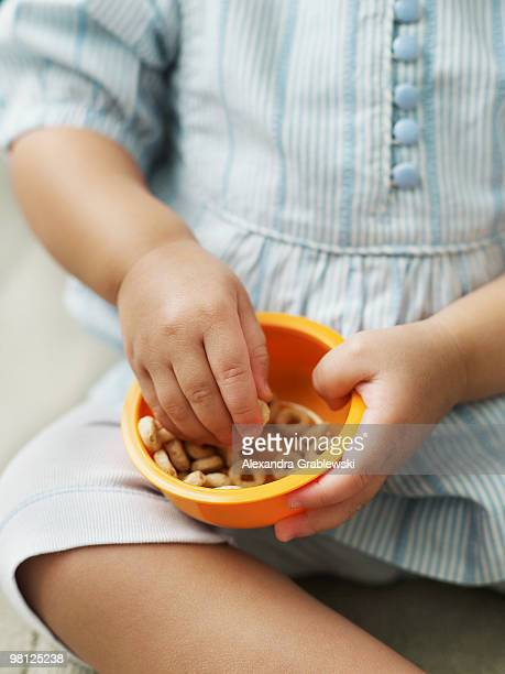Toddler girl eating cereal
