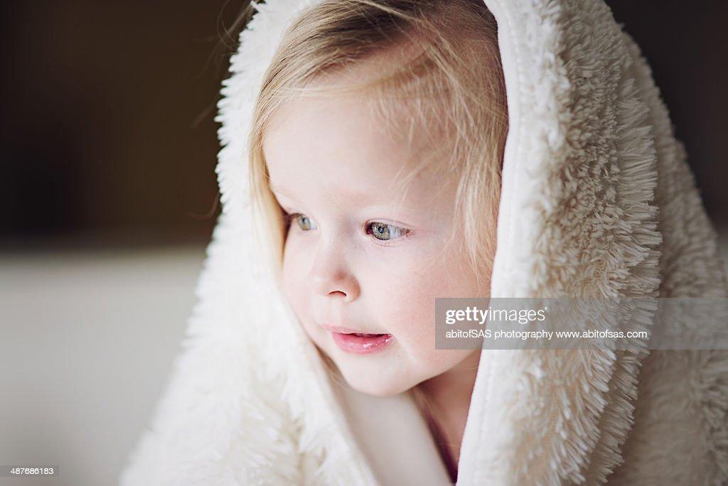 Toddler girl in blanket