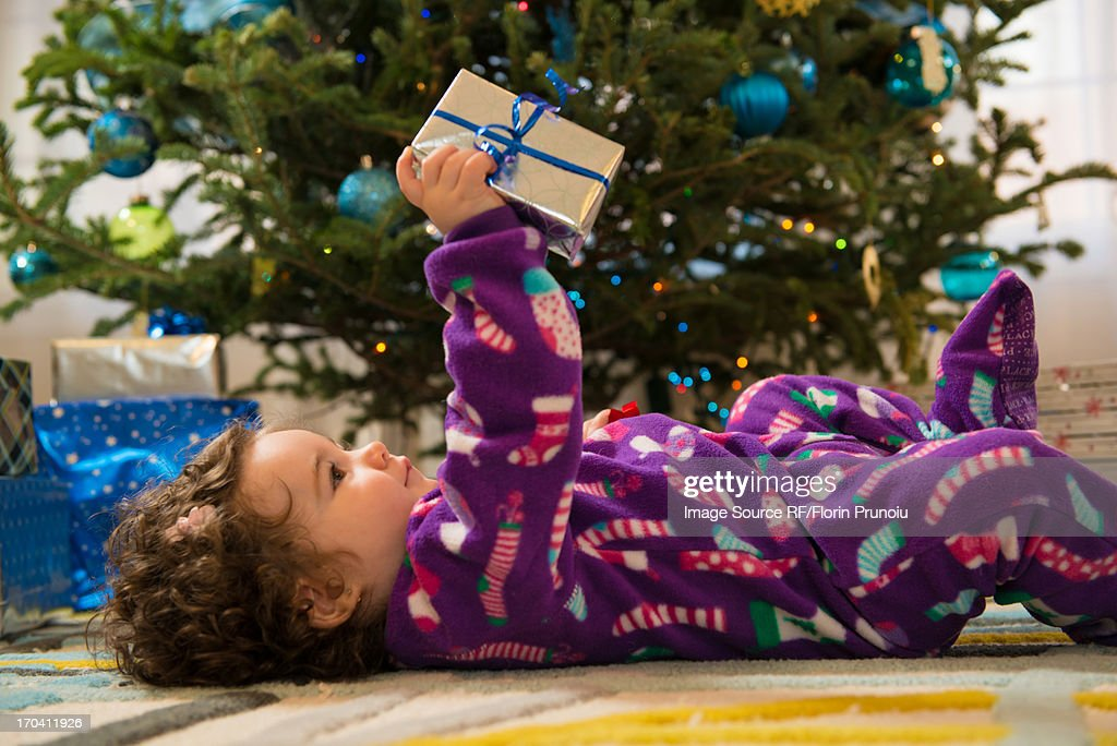 Toddler girl opening Christmas gifts : Stock Photo