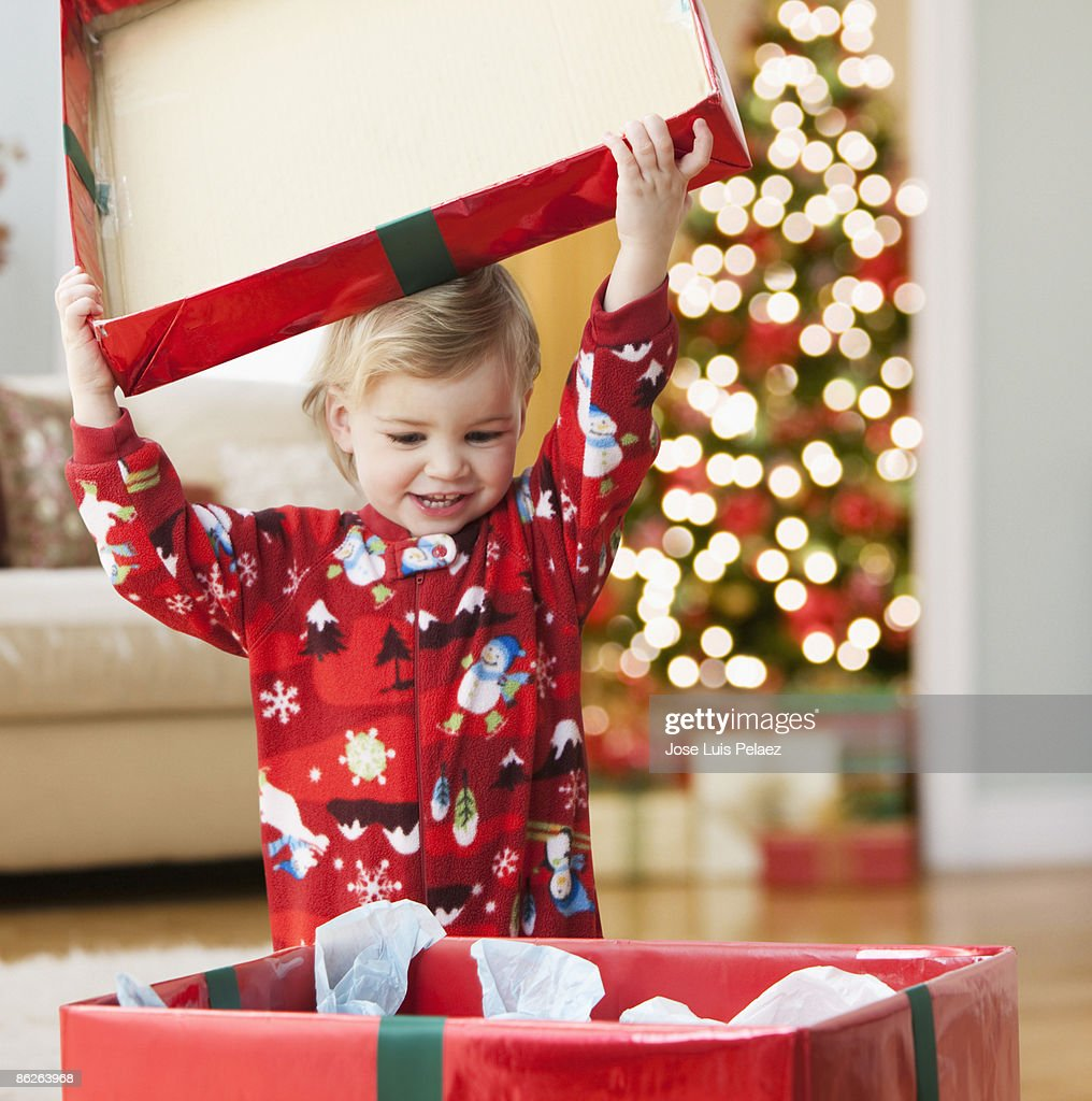 Toddler girl opening presents : Stock Photo