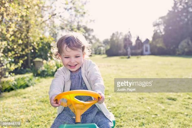 Toddler Girl Playing in Garden