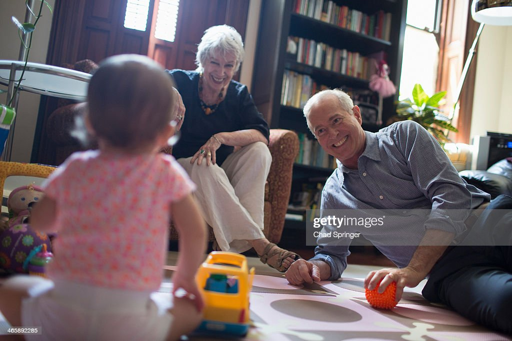 Toddler girl playing with grandparents