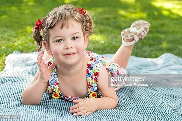 Toddler girl posing on tummy