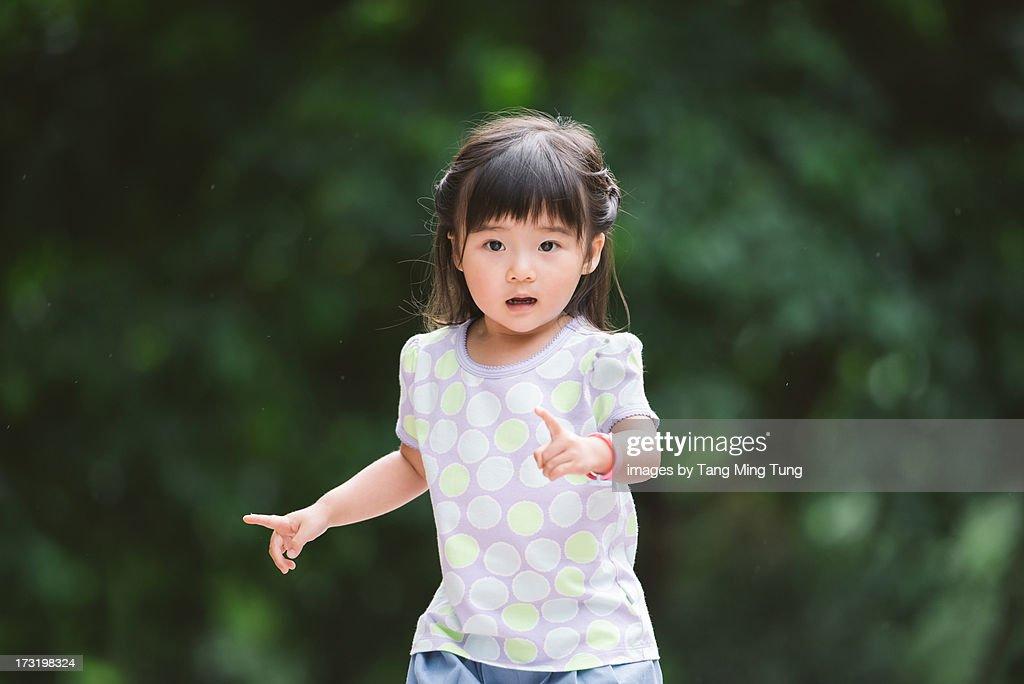 Toddler girl running in the park : Stock Photo
