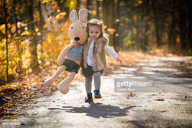 toddler girl running on road