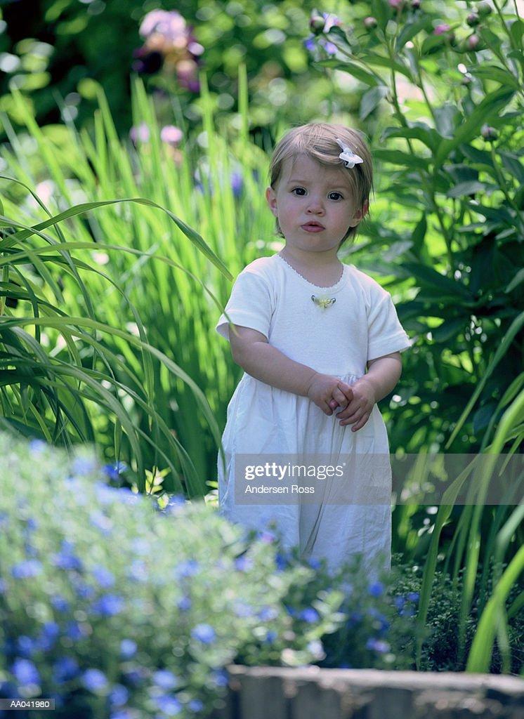 Toddler Girl Standing in Garden