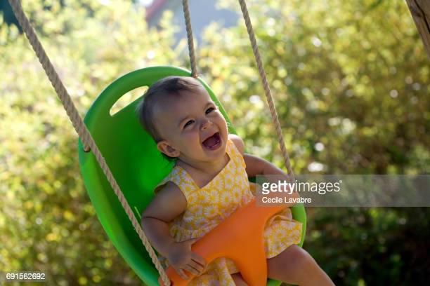 Toddler girl swinging