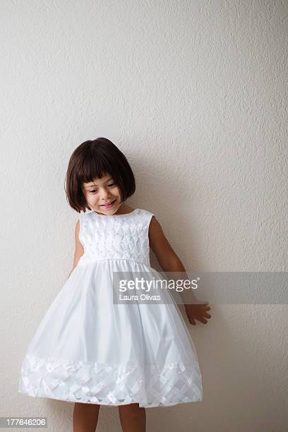 Toddler Girl Wearing a White Dress