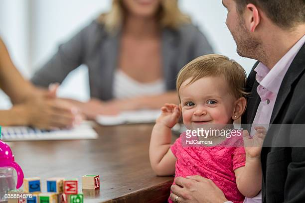 Toddler Happily Playing While Her Dad Works