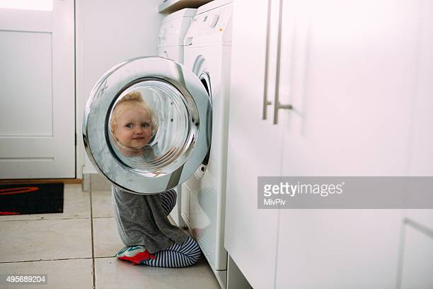Toddler helping with the laundry