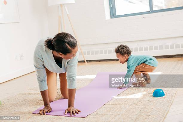 Toddler helps with yoga pad