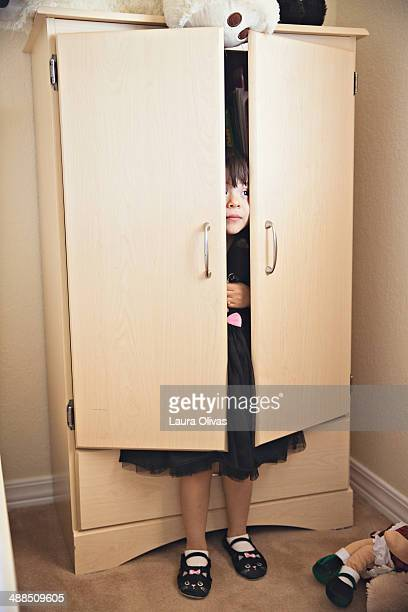 Toddler Hiding In Armoire