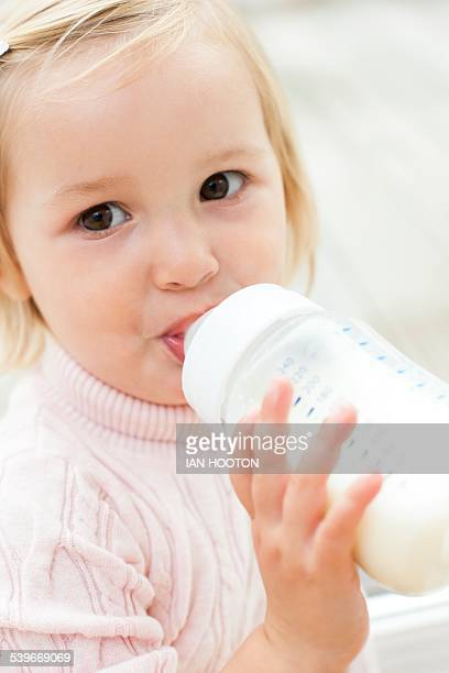 Toddler holding a bottle of milk