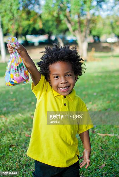 A toddler holding an easter bag