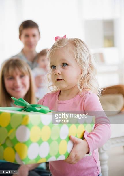 Toddler holding gift