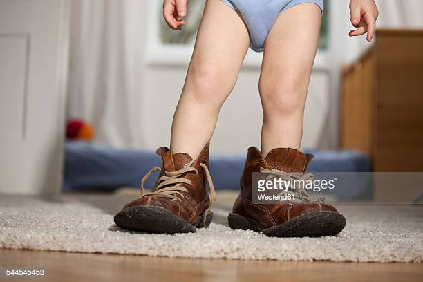 Toddler in fathers shoes