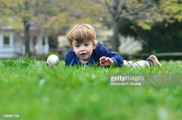 Toddler in grass at park