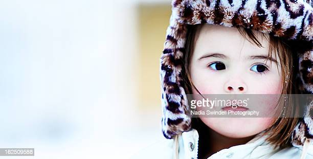 Toddler in leaopard hat