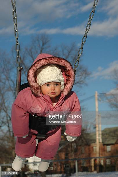 Toddler in Snowsuit on Swing