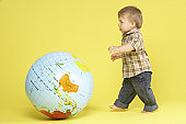 Toddler In Studio With Globe