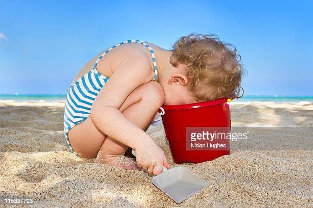 Toddler looking into Bucket
