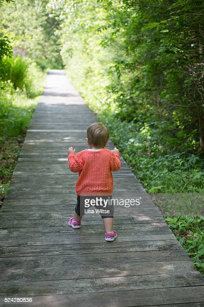Toddler making first steps in spring nature Photo by Lisa Wiltse